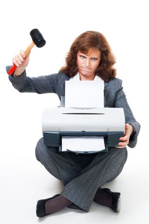 printer ink: Business woman in formal clothes angry on her printer and crushing it with hammer Stock Photo