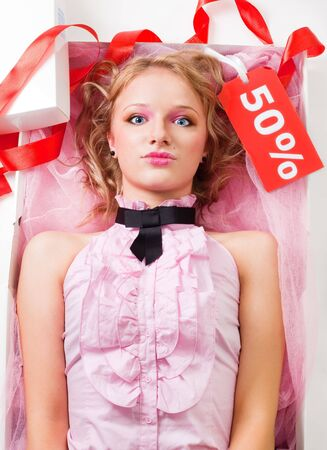 fashion doll: Doll like woman lay in present box with sale tag