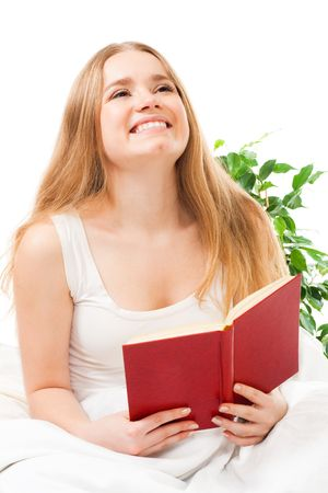 Woman read book sitting in bed and laughing Stock Photo - 6140600
