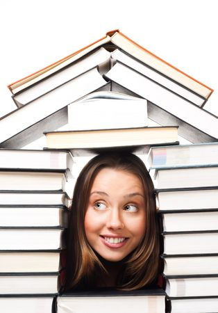 amiable: Happy laughing woman in house made of pile of books, closeup