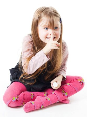 sh: Funny little girl sitting on the floor smile and gesturing Stock Photo