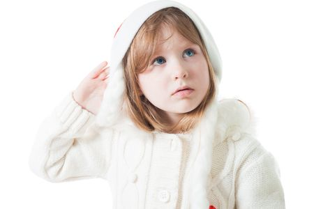 misunderstanding: Cute little girl in new year cap with misunderstanding look