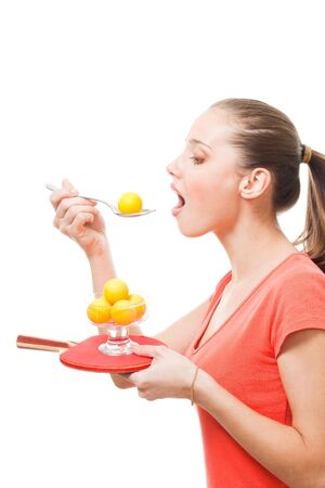 Taste table tennis sport concept - woman with racket and orange balls photo