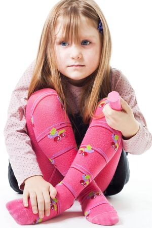 Sad little girl with color chalk Stock Photo - 6204881