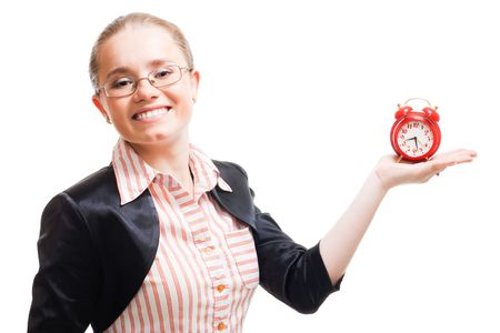 Young positive woman wear glasses and hold old-style alarm clock photo