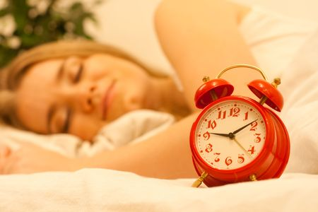 red alarm and woman sleep on background photo