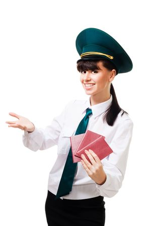 customs: Positive custom control worker with smile hold passports and welcome