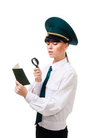 Customs control worker woman carefully check passport on border Stock Photo