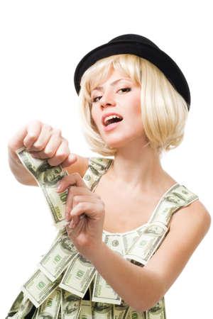 Woman tear apart US dollar, wearing dress made of dollars photo