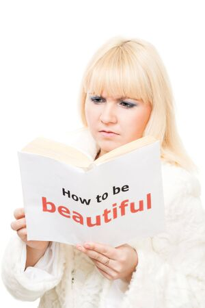 misunderstanding: Blond woman want to be beautiful reading a book and show misunderstanding
