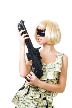 Bank robbery - woman in dress made of dollars and mask with rifle photo