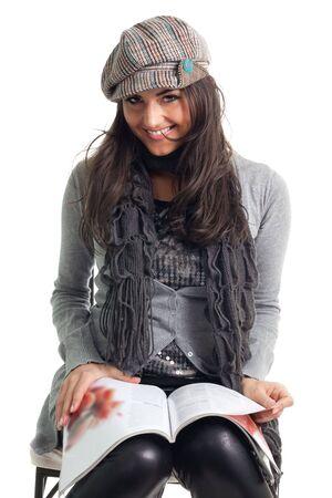 Stylish young woman read magazine with big smile photo