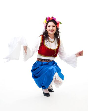 Woman squat dancing with kerchief in Greek national costume photo