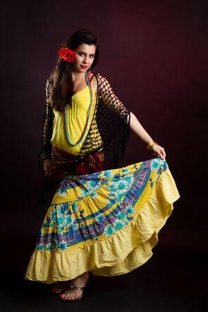 gypsy woman: Gypsy woman dance in yellow dress on dark background