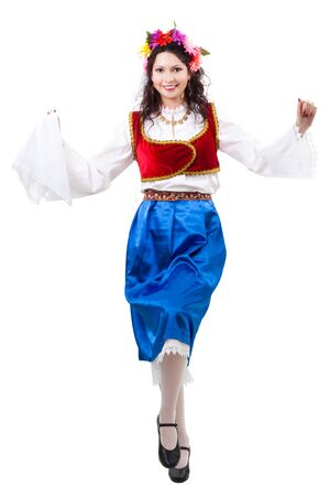 Greek woman squat dancing in traditional costume photo