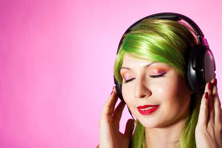 face of a happy woman listen music with closed eyes photo