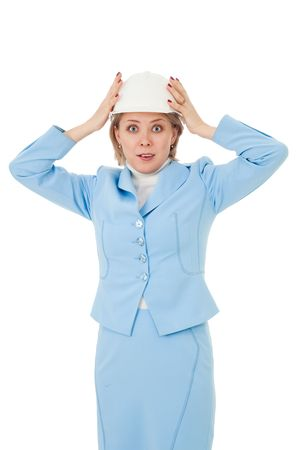 Shocked woman engineer holding head with hands photo