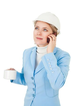 Positive architect woman calling by phone during break photo