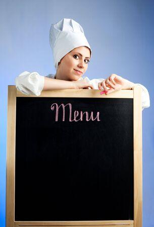 Chef show lunch menu on blackboard photo