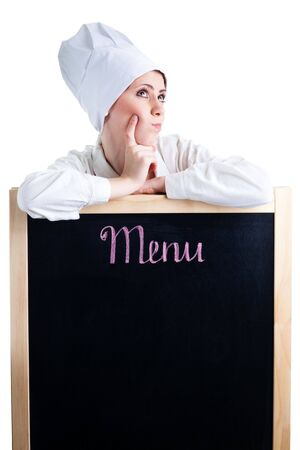 Chef thinking about lunch menu leaning on blackboard photo
