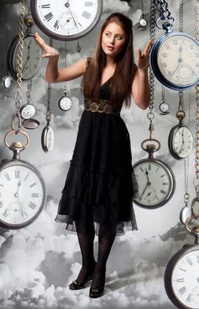 instrument of time: Woman walking among watches in the cloud like in dream