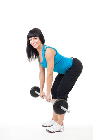 free weight: Woman instructor show dead lift exercise with free weight Stock Photo