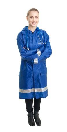 happy looking nurse standing in blue uniform Stock Photo - 7254262