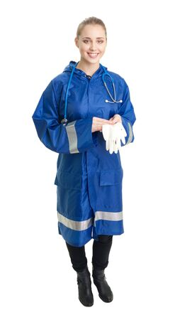 Happy doctor stand and smile with surgical gloves, isolated on white photo