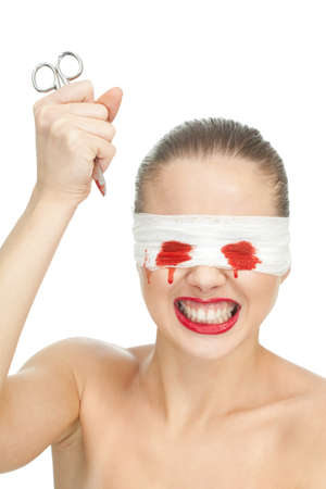 Aggressive harmed woman with scissors and blood bandage on her face photo