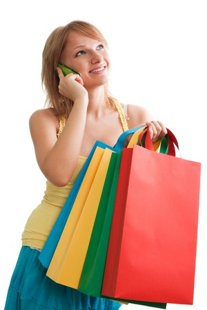 Pretty woman with colorful bags smiling and talking Stock Photo - 7708676