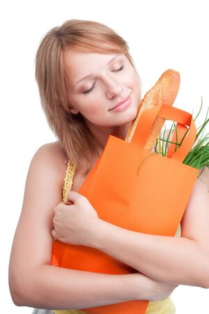 woman with yellow bag dreaming about healthy diet photo