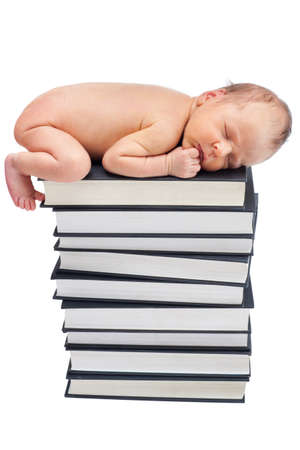 Lovely newborn baby sleep on pile of books photo