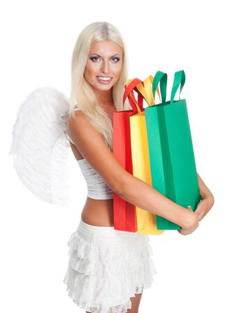 Angel woman hold many shopping bags isolated on white photo