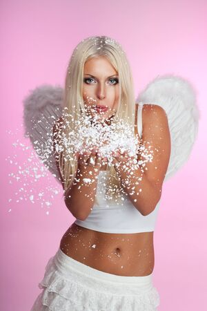 blow: Angel blow off snow from her hands with wings on pink