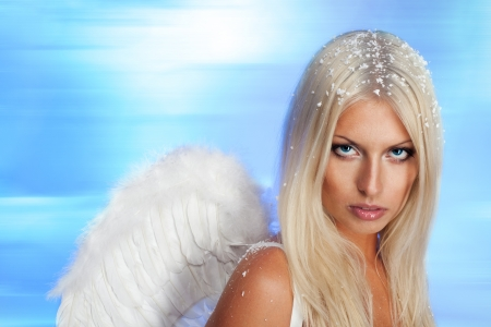 Beautiful blond angel and northern lights background Stock Photo - 7709058
