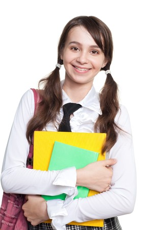 Happy teen girl holding books and backpack and wide smile Stock Photo - 7709167