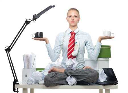 Keeping balance between god and evil in work - woman sitting on work table photo