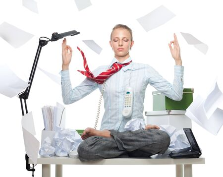 Calm business woman despite huge disorder on table and flying papers photo