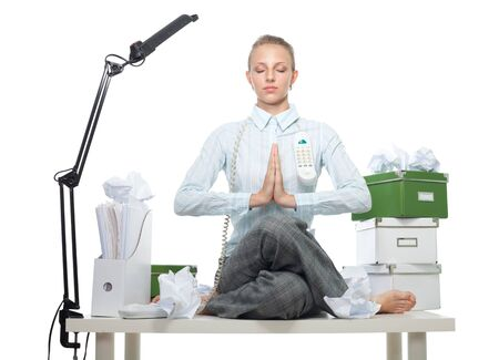 Calm confident business woman sitting on a table maintaining photo
