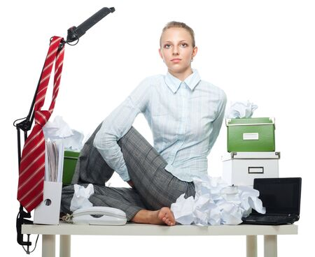 Flexible business woman in office sitting on her table photo