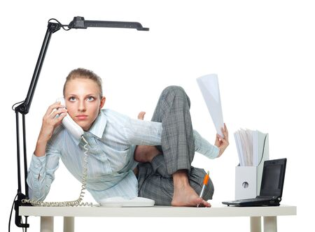 Flexible woman in office doing multiple jobs at the same time photo