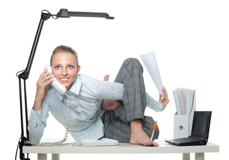 Flexible business woman talk by phone sitting in crooked pose and doing several things photo