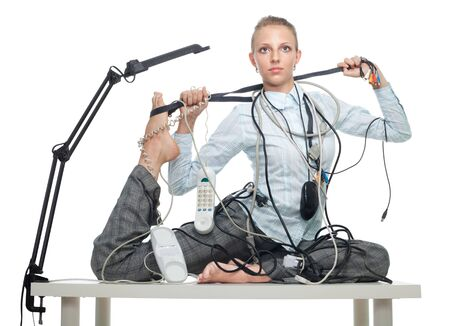 Flexible business woman dealing with disorder that disturb her from work photo