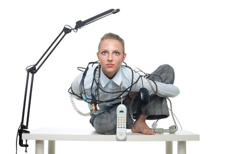 Constrained office young woman worker willing to overcome problems photo