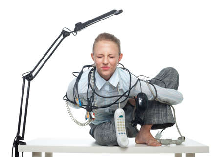 constrained office worker with problems and wires in yoga pose photo