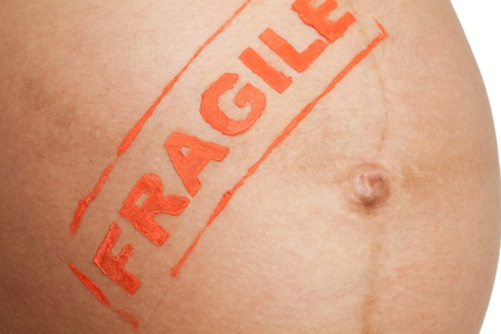 Pregnancy is fragile - close-up of tummy of pregnant woman photo