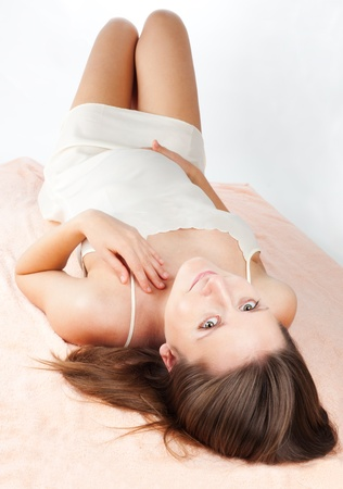 Joyful labor - pregnant woman laying on the blanket and smiling photo