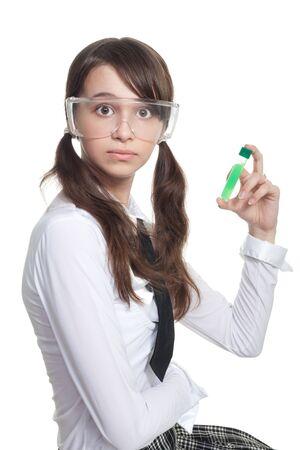 misunderstanding: Surprised teenager with test tube expressing misunderstanding Stock Photo
