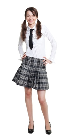 full length portrait of teen schoolgirl in formal clothes photo
