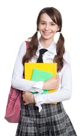 ponytails: Happy teenage schoolgirl with books, backpack and ponytails Stock Photo